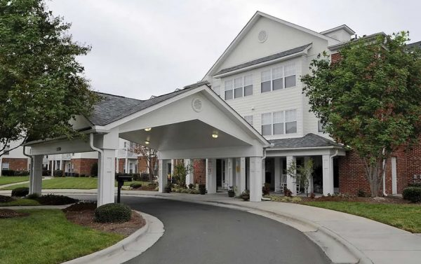 Covered driveway and entrance to The Meadows at Brier Creek
