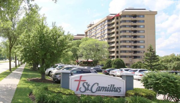 Welcome sign and building exterior at St. Camillus Independent Living