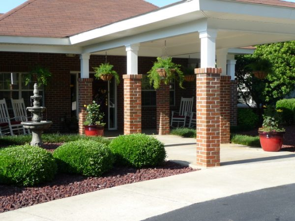 Covered front entrance and walkway at Autumn Cove