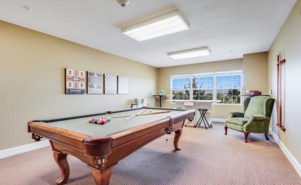 Gray felt pool table in the Keystone Place at Legacy Ridge billiards room