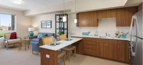 Apartment interior with eat in kitchen and spacious living room in Merrill Gardens at Anthem