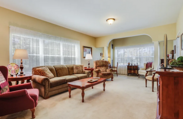 Model living room in a residence in Keystone Place at Legacy Ridge