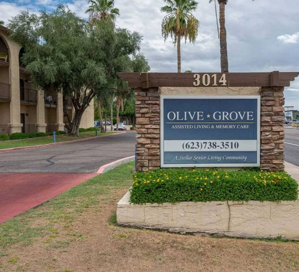 Entrance sign in front of Olive Grove Retirement Community