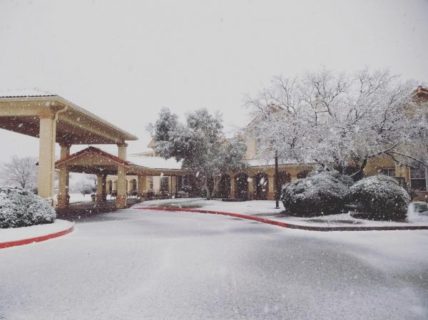Prestige Assisted Living at Sierra Vista building exterior covered in snow