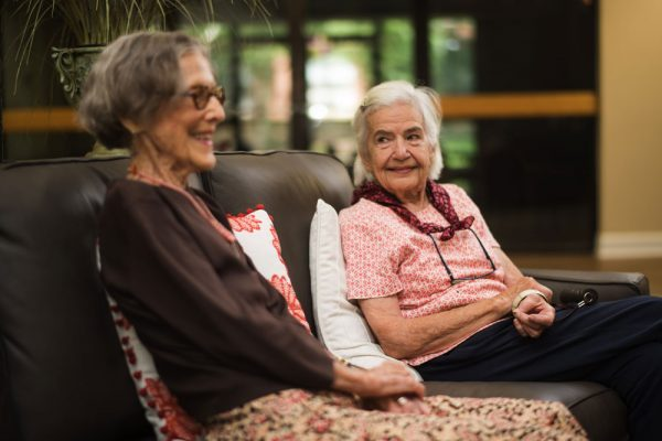 Two women sitting and smiling at St. Martin's in the Pines