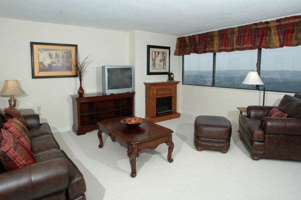 Mount Royal Towers model living room with fireplace