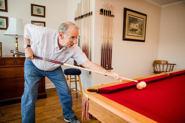 Westminster Village male resident shooting pool