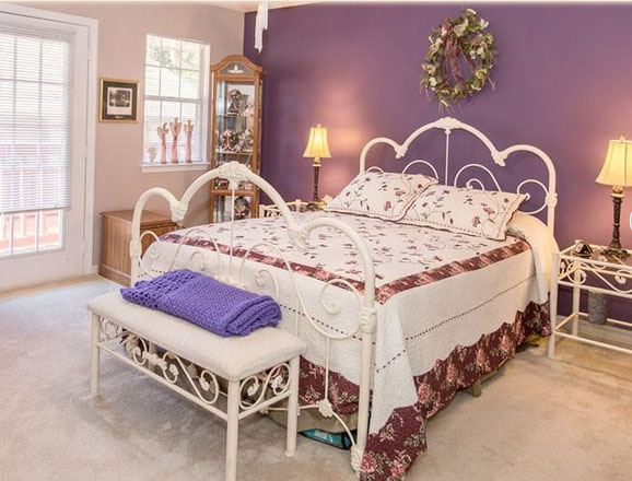 Model bedroom in an apartment at Country Club Village