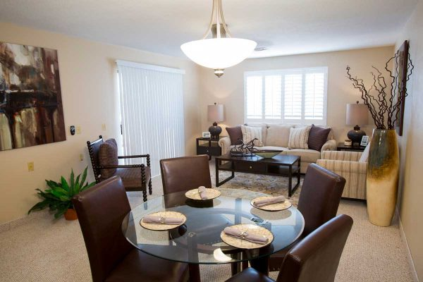 Model apartment interior and dining area at Sierra Winds
