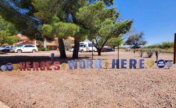 Heroes work here sign in front of Prestige Assisted Living at Sierra Vista