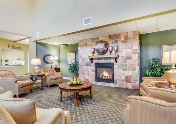 Living area and fireplace in Keystone Place at Legacy Ridge
