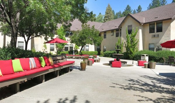 Outdoor courtyard and resident seating at Hilltop Commons