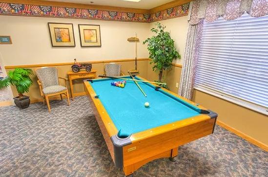 Green felt pool table in the Skyline Place billiards room