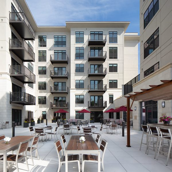 Courtyard and outdoor dining tables at St. Rita Square