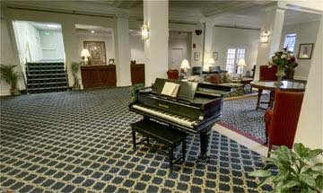 Lobby with a grand piano at Greenbriar at the Altamont