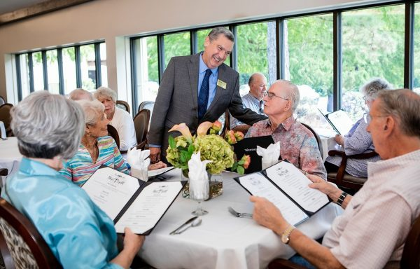 Westminster Village residents viewing menus in the community dining room