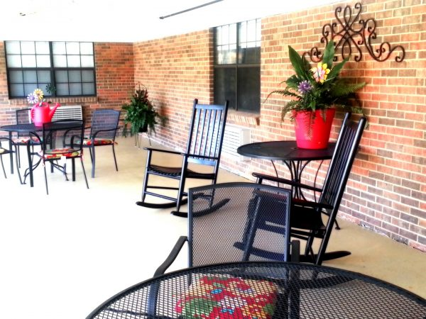 Porch with black rocking chairs at Cherokee County Health and Rehabilitation Center