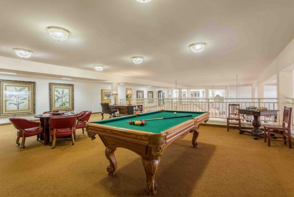 Billiards and card room with green felt pool table in Apple Blossom