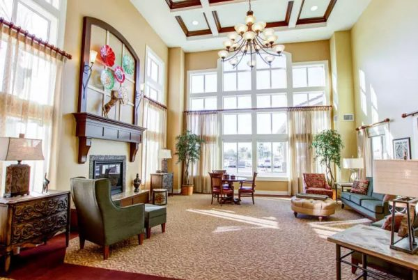The Groves, A Merrill Gardens Community grand lobby and resident seating