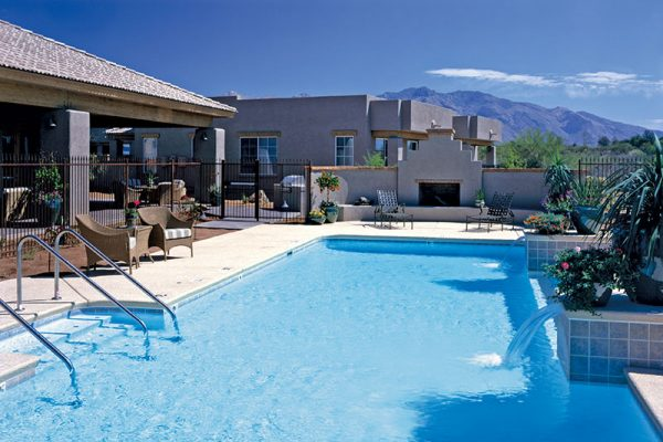 Outdoor swimming pool and fireplace at The Fountains at La Cholla
