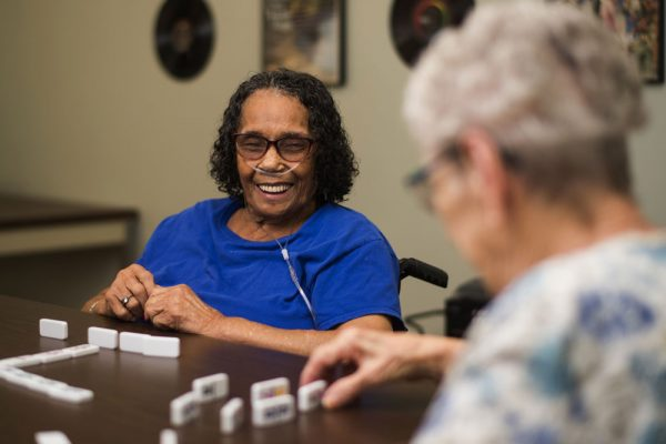 St. Martin's in the Pines female residents playing dominoes