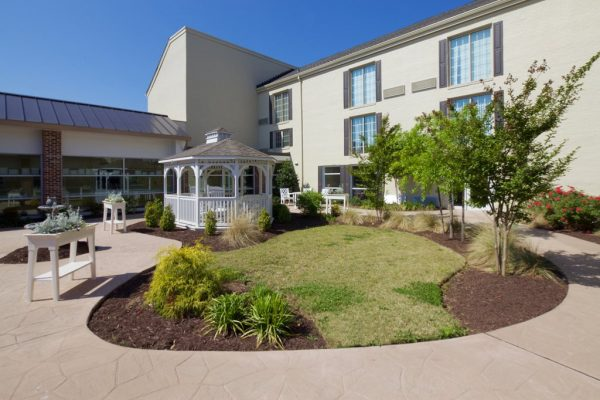 Commonwealth Senior Living at Leigh Hall exterior view with community gazebo