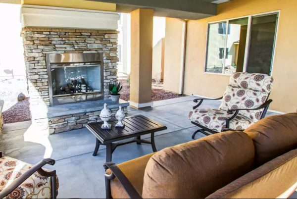 The Groves, A Merrill Gardens Community outdoor fireplace and resident gathering area