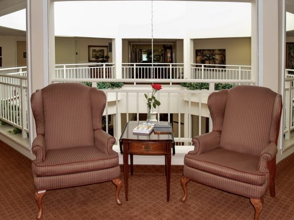 Resident seating in wing back chairs in Rocky Ridge