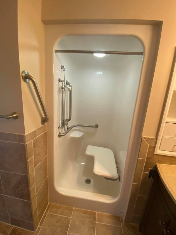 North River Village apartment walk in shower with safety equipment