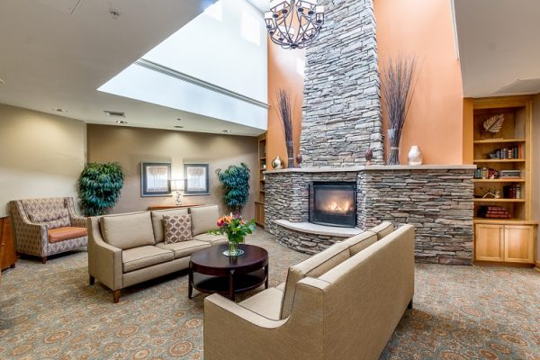 Sofas in frint of the stone fireplace at Hawthorn Court at Ahwatukee