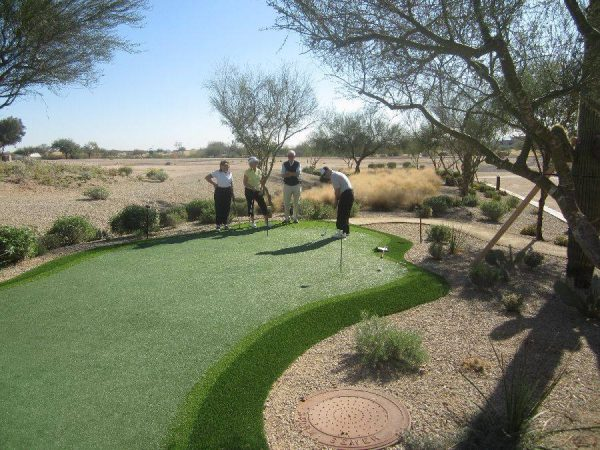 Maravilla senior residents playing golf on the putting green