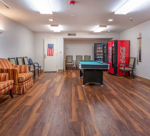 Game room with billiards table in Olive Grove Retirement Community