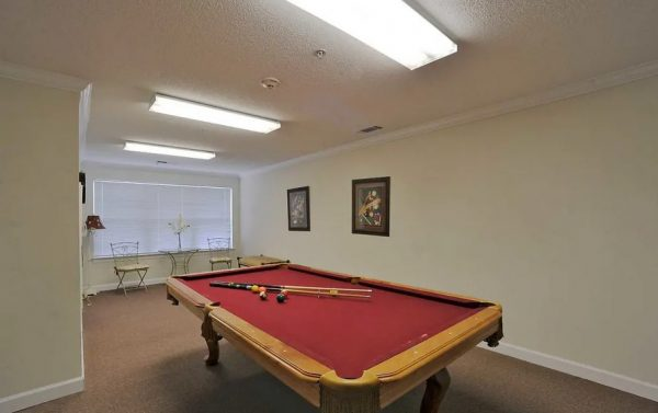 Red felt pool table in the The Meadows at Brier Creek billiards room
