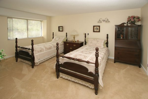Twin beds in a model apartment at Mount Royal Towers