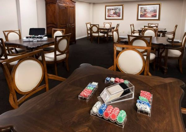 Card tables in the Freedom Plaza Care Center game room