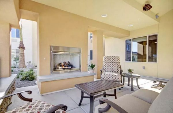 Outdoor fireplace and seating at The Oaks in Gilbert AZ