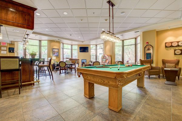 Fountain View Village bar and lounge with a green felt pool table and card tables