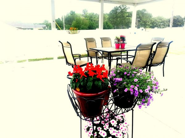 Covered porch and dining table at Cherokee County Health and Rehabilitation Center