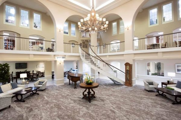 Freedom Plaza Care Center grand foyer and lobby with curved staircase and a grand piano
