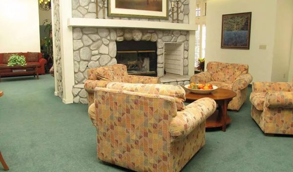 Chairs in front of the fireplace in the Hilltop Commons community living room