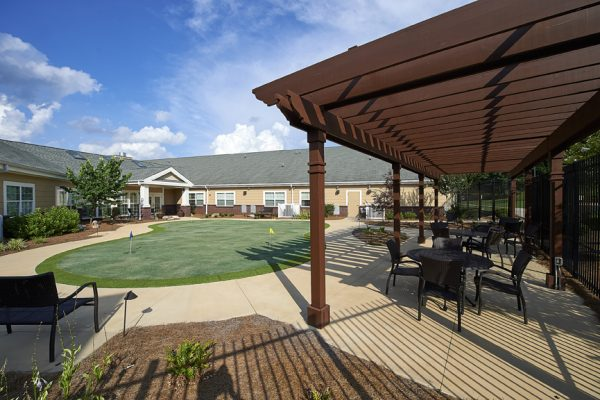Putting green and outdoor trellis for residents of Redstone Village