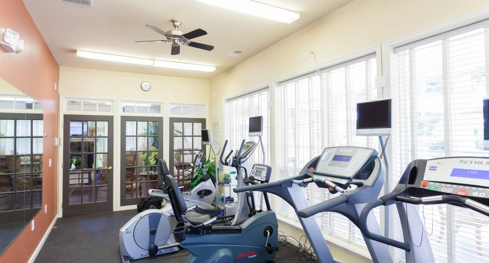 Gym room with exercise equipment at Alexander Heights