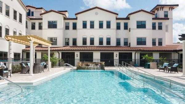 American House Senior Living Communities exterior building with swimming pool