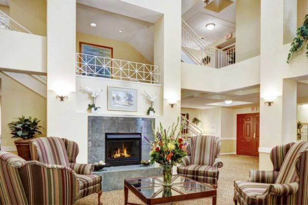 Community living room and fireplace in Addison Place at Glastonbury