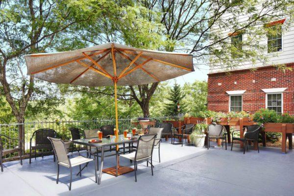 Addison Place at Glastonbury patio and umbrella table