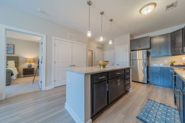 Kitchen of an apartment at Belvedere at Berewick with large center island