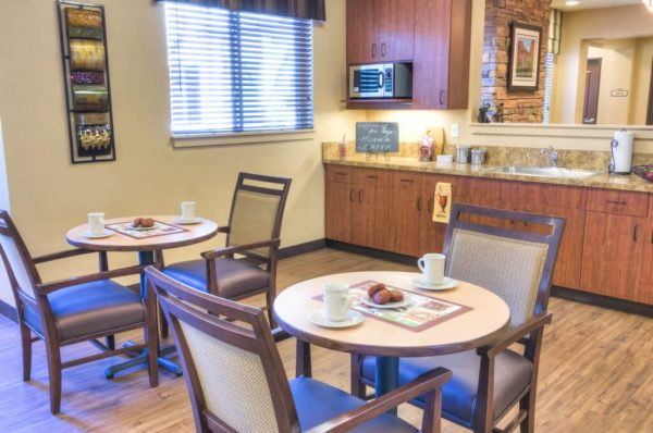 Breakfast nook with two top tables in Catalina Springs Memory Care