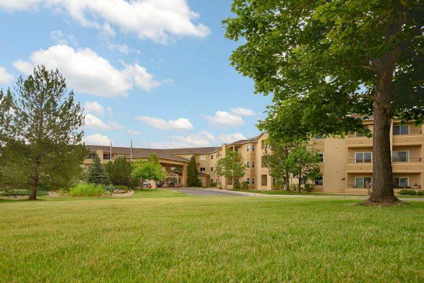 Cherry Creek Retirement Village building exterior and lawn