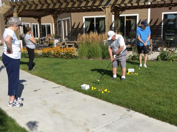 Men having a chipping contest at SilverCreek on Main