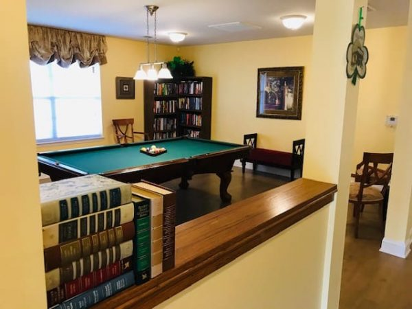 Billiards room with green felt pool table in the recreation room of Crossings at Heritage
